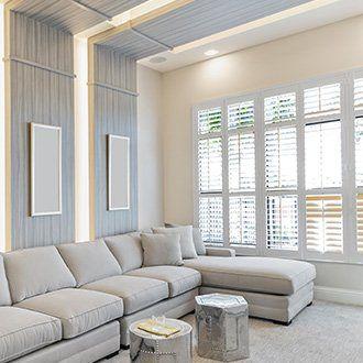 White Venetian blinds in a living room