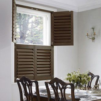 Brown tier on tier shutters in a dining room