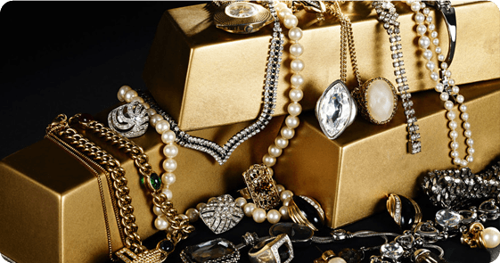 Piles of jewellery on gold bars