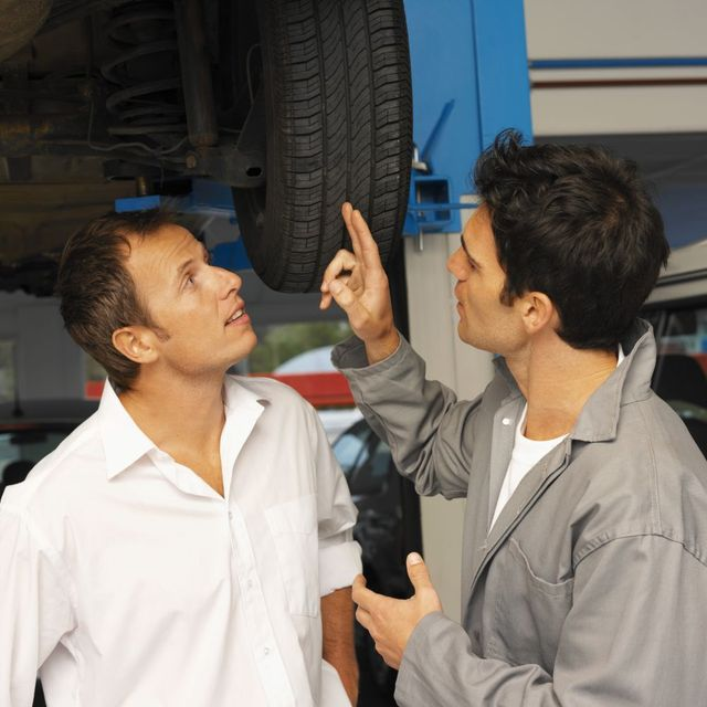 Mechanic explaining client what he repaired on the car
