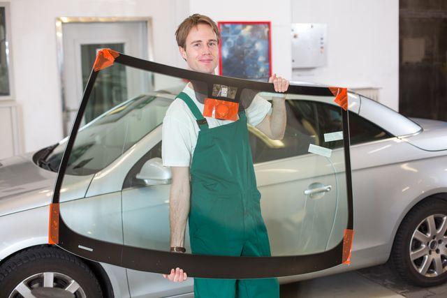 Mechanic replacing a windshield