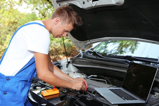 Mechanic resetting car system with a laptop