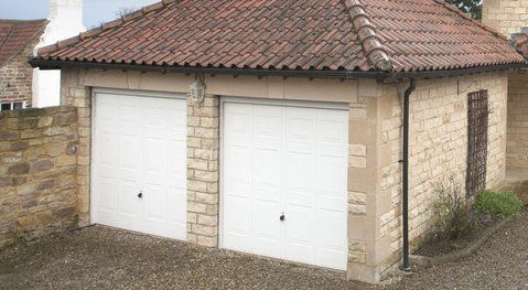 dual white garage doors