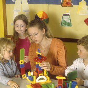 teacher teaching an activity to her students