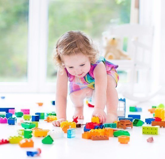girl playing the block game