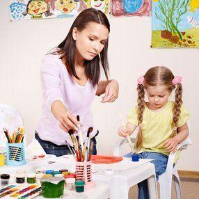 teacher helping her student