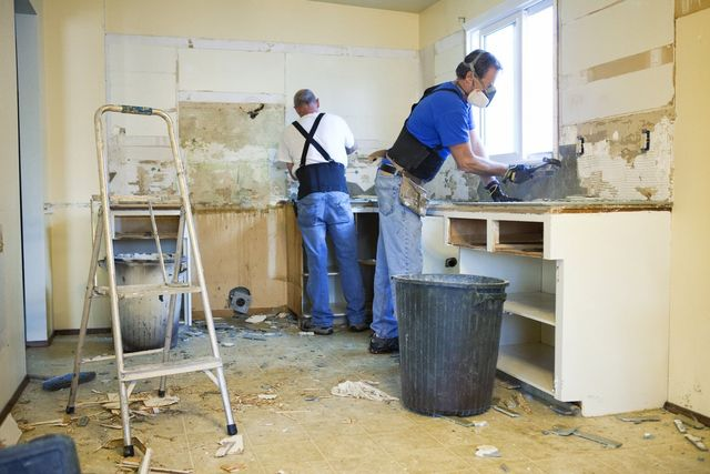Image result for several workers renovating house