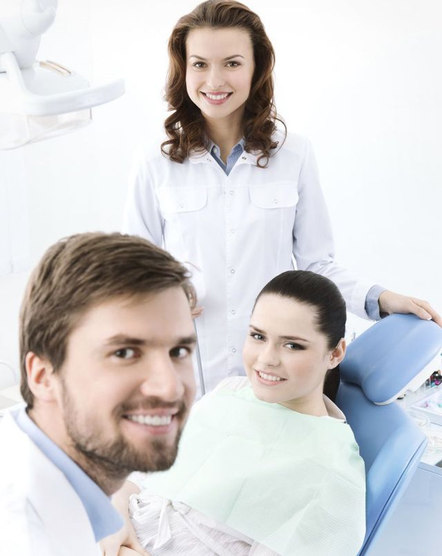 Dentist with patient getting a dental bridge in Webster, NY