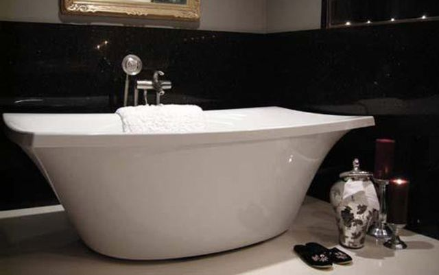 bathtub and vase with slippers