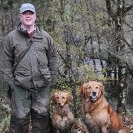 peter hargreaves with 2 dogs