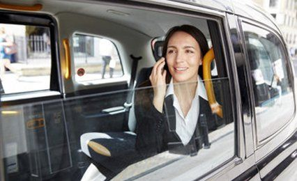 a lady talking on the mobile phone