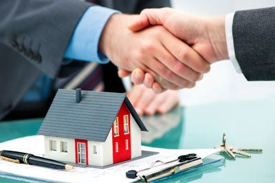 Mortgage Loans — Handshakes with customer after contract signature in Shelby, NC