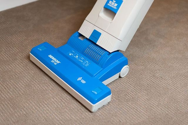 Worker cleaning the floor with polishing machine