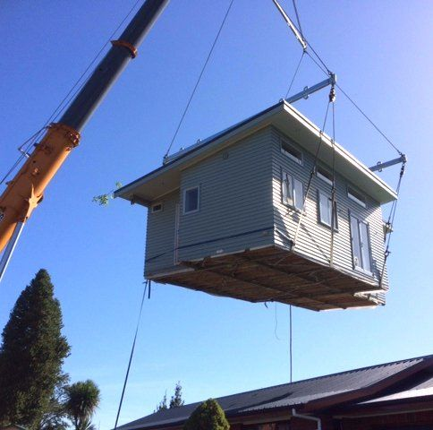House being reallocated with the help of crane in Paengaroa