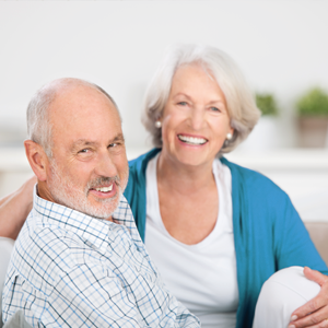 A happy patient and his wife after visiting our Chiropractic Center