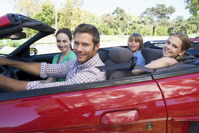 Happy family with car insurance in Bolivar, MO