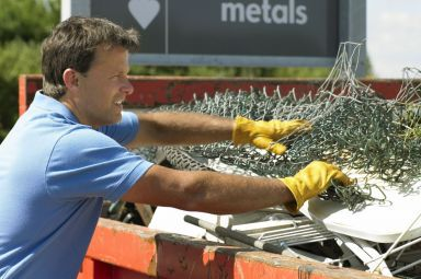Man recycling scrap metal in the South Island