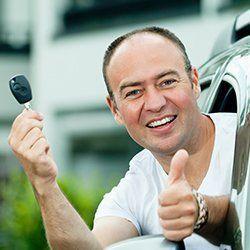 A man holding a key