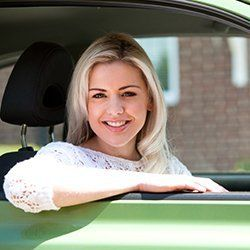 A woman sitting in the car