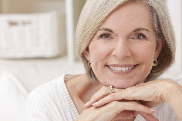 Middle aged woman with porcelain veneers