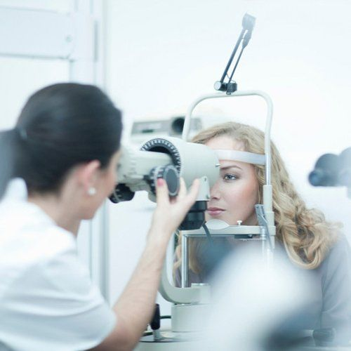 An optician carrying out digital imaging of the eye