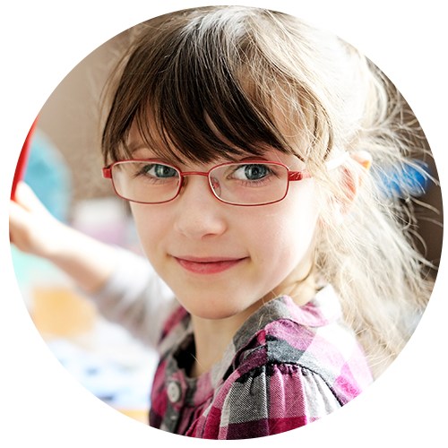 A little girl in a check shirt, wearing glasses with thin red frames