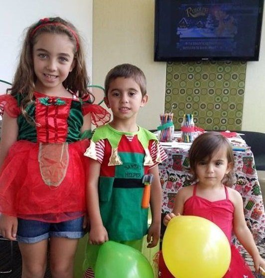 children in christmas clothes