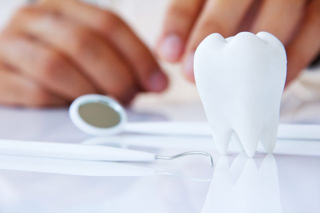 white teeth cleaning with dentist mirror