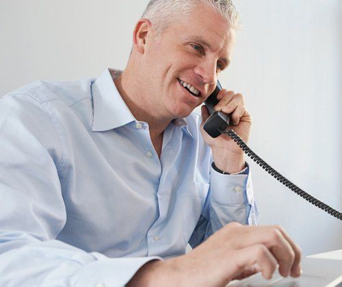 A man talking over the phone