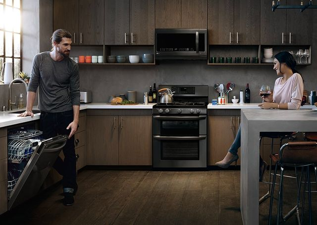 Dark Stainless steel Frigideaire appliances with modern wood cabinets