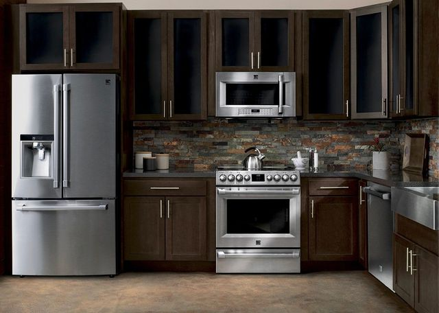 Stainless Steel KitchenAid Appliances With Modern Dark Wood Cabinets