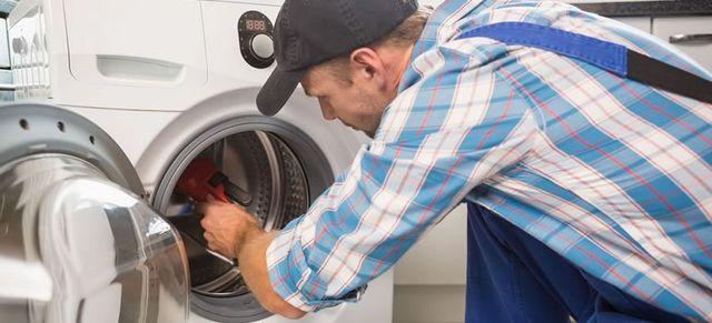 Nuttermans repair man repairing a dryer