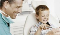 Happy child receiving dental health services in Whangarei