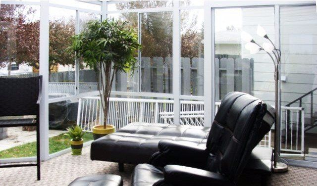 Canadian factory direct sunrooms image of a furnished sunroom interior solutioingenieria Images