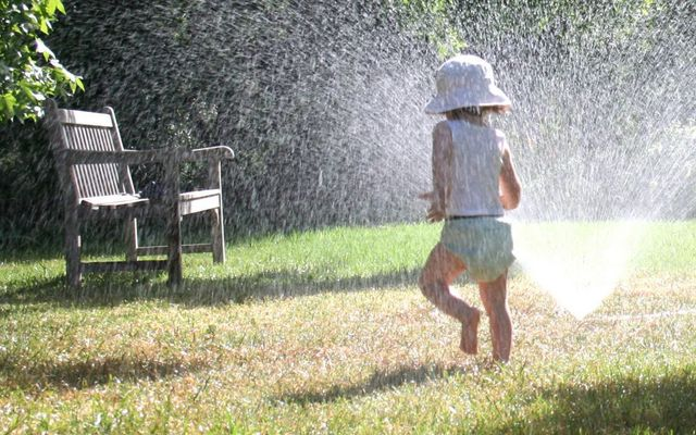 playing around water sprinklers in yard with pump installation Lamesa, TX