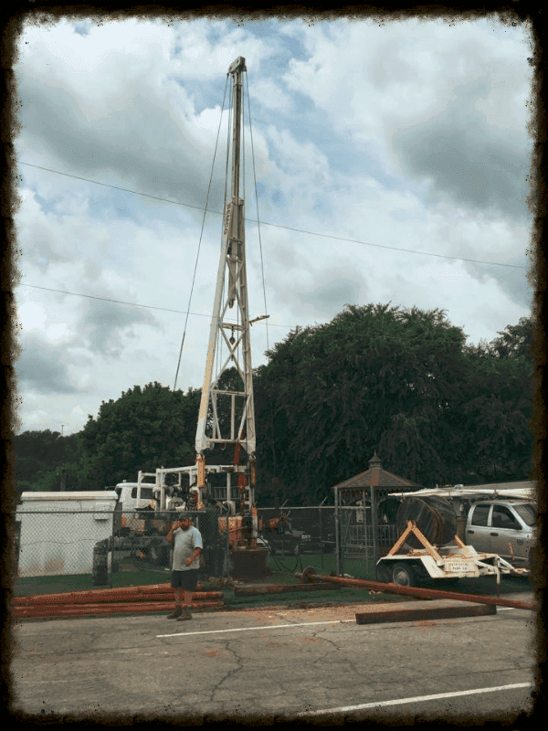 A white drilltower of Washington Pump and Drilling