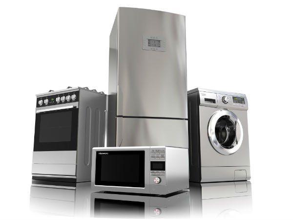 Cucina. microonde, lavatrice e frigorifero