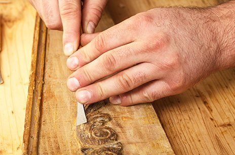 Skilled craftsman using a wood chisel