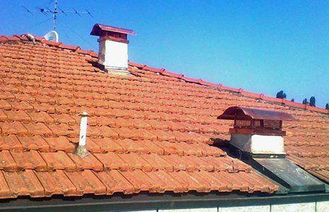 Nuove tegole e camini di ottone danno un nuovo aspetto al tetto