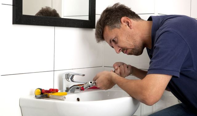 Fixing a sink as part of our plumbing solutions in San Marcos, TX