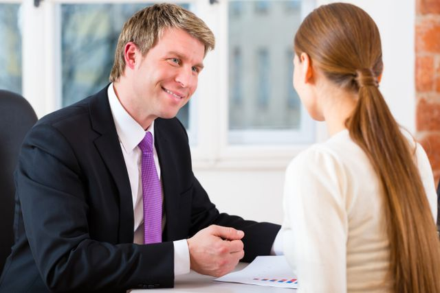 Professional lawyer working in his office and has a consultation with a female customer