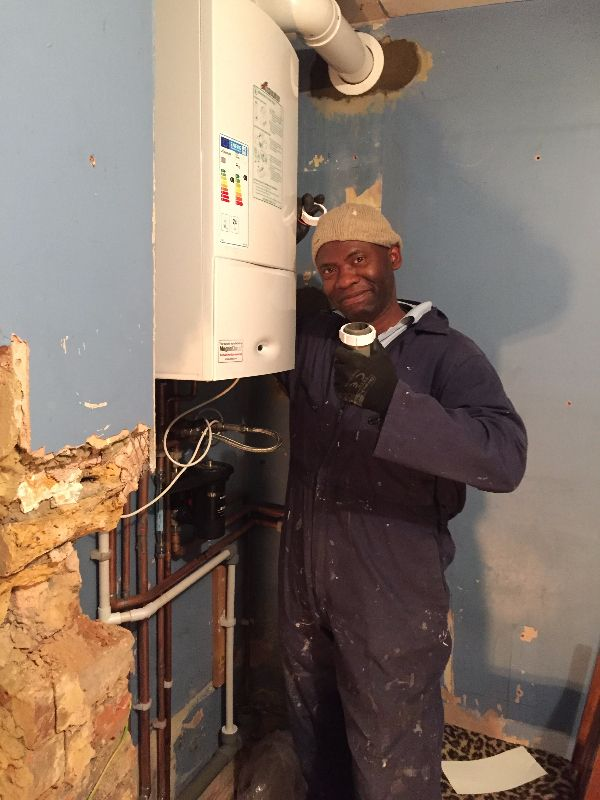 engineer fixing a heating system