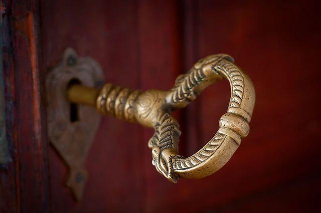 A door with antique beautiful bronze key in Mystic