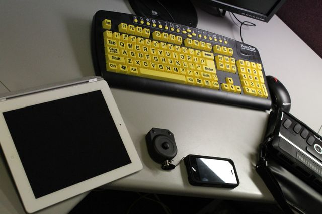 ipad, high contrast keyboard, braille reader and iphone