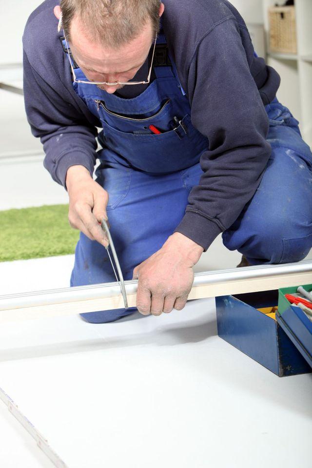 Worker making aluminium shop fronts in Rotorua