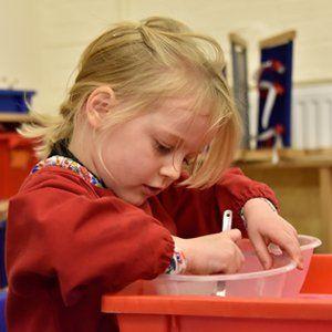girl doing an art work