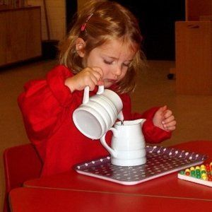 girl playing with jugs