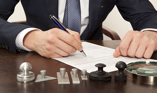 Client reading the documents for compensation law case in Chattanooga, TN