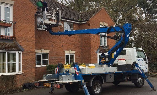 vehicle with crane used to reach the roof