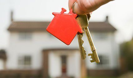 individual holding house keys